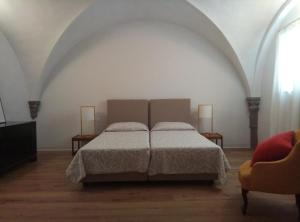 A bed or beds in a room at Palazzo Capponi
