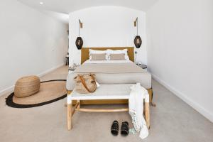 A bed or beds in a room at Altera Pars Suites