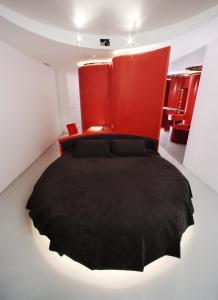 Cama o camas de una habitación en Hotel Puerta America