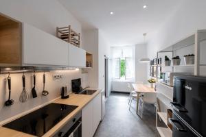 A kitchen or kitchenette at Apartment Slavikova 11