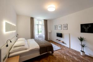 A bed or beds in a room at Apartment Slavikova 11