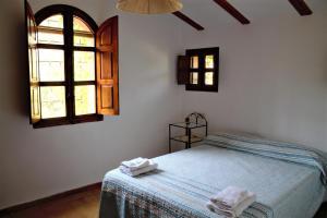 Cama o camas de una habitación en Molino de Abajo de Bullas