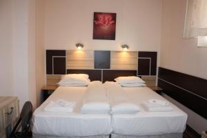 Ein Bett oder Betten in einem Zimmer der Unterkunft Hotel Orlando