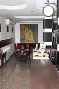 Ein Restaurant oder anderes Speiselokal in der Unterkunft Hotel Orlando