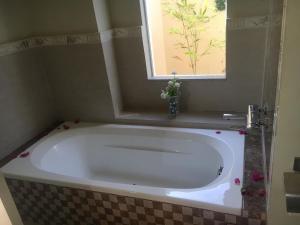 A bathroom at Venezia Suites