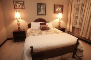 A bed or beds in a room at The Grand Hotel Wanganui