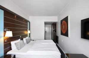 En eller flere senge i et værelse på Imperial Hotel