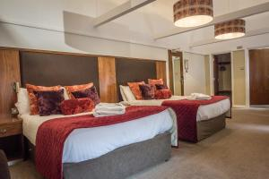 A bed or beds in a room at Hellaby Hall Hotel; BW Signature Collection