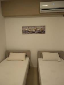 A bed or beds in a room at Skopje Apartment