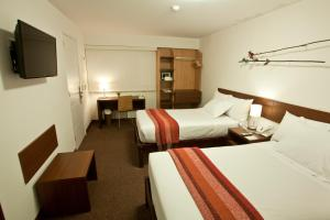 A bed or beds in a room at Tierra Viva Miraflores Larco