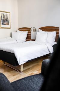 Säng eller sängar i ett rum på Piteå Stadshotell