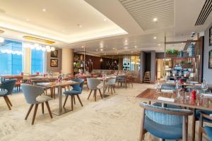 مطعم أو مكان آخر لتناول الطعام في Hilton Garden Inn London Heathrow Terminal 2 and 3