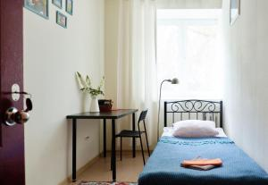 A bed or beds in a room at DoBeDo Hostel