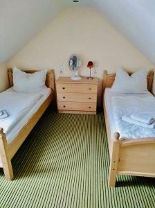 A bed or beds in a room at Hotel St. Anna