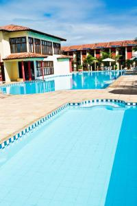 The swimming pool at or near Residencial Jerusalém I - Tonziro