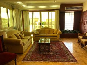 A seating area at Family Apartment In Al Choueifat Near Downtown.