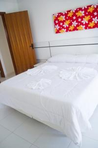 A bed or beds in a room at Residencial Mont Moria - Tonziro