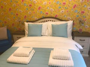 A bed or beds in a room at The Rookery