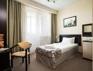 A bed or beds in a room at Barkhatnye Sezony Russky Dom Resort Sportivny Kvartal