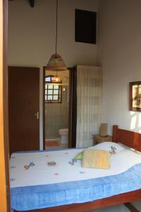 A bed or beds in a room at Chale Ilhabela