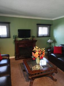 A television and/or entertainment centre at Your Oasis in Niagara Falls Canada
