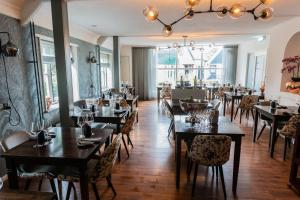 A restaurant or other place to eat at Hotel Brasserie Rebecca
