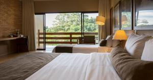 A bed or beds in a room at Santa Clara Eco Resort