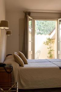 Кровать или кровати в номере Si Montalcino Hotel & Restaurant