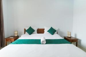 Ein Bett oder Betten in einem Zimmer der Unterkunft Canggu Nadi Guest House