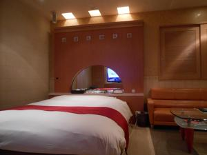 A bed or beds in a room at Hotel Will Takao (Adult Only)