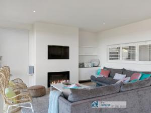 A seating area at Pukeko Beach House, Rhyll