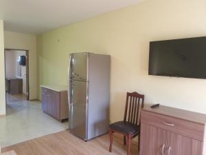 Телевизор и/или развлекательный центр в Calypso All inclusive Resort Hotel
