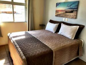 Cama o camas de una habitación en Pousada Mar Do Leste