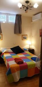 A bed or beds in a room at Planta Baja Independiente en chalet duplex