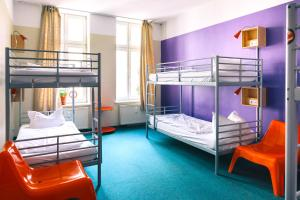 A bunk bed or bunk beds in a room at St Christopher's Inn Berlin Alexanderplatz