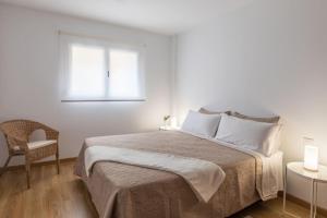 Postel nebo postele na pokoji v ubytování Apartamento La Nuit con Parking gratis en centro histórico