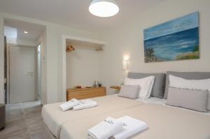 A bed or beds in a room at Hotel Naxos Beach