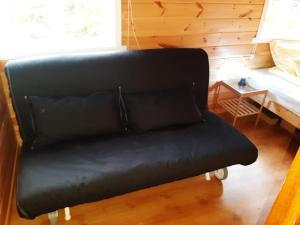 A seating area at Cozy Cottage in the Woods, near Dyreparken in Kristiansand, Lake Lolandsvannet