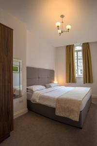 A bed or beds in a room at The Castle Collection - 25 Castle Street