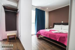 A bed or beds in a room at Mansion Hotel