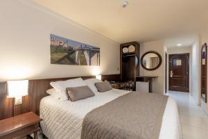 Cama ou camas em um quarto em Bogari Hotel