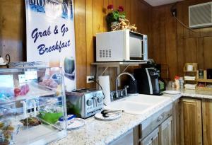 A kitchen or kitchenette at Gorham Motor Inn