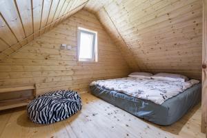 Łóżko lub łóżka w pokoju w obiekcie Miejsce Mocy