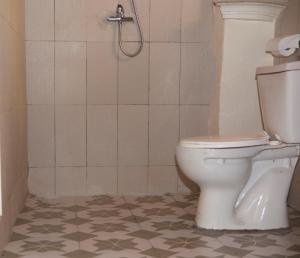A bathroom at Residence Hotel Lwili