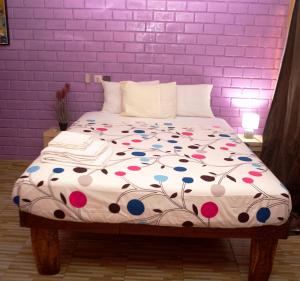 A bed or beds in a room at Residence Hotel Lwili