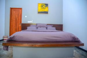 A bed or beds in a room at Richards Cabanas