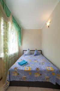 A bed or beds in a room at Guest House Irina