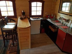 A kitchen or kitchenette at Chata Nad Jeziorem