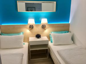 A bed or beds in a room at MyHome Riviera - Cannes Sea View Apartment Rentals