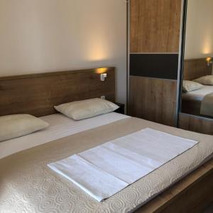 Postel nebo postele na pokoji v ubytování Apartments Sea Vodice